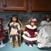 Identifying Porcelain Dolls - 4 dolls on stands