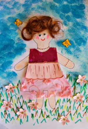 Flower Girl Kid Collage Activity - finished artwork with butterflies glued in place