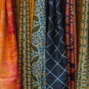 Variety of fabric hanging.