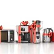 Small kitchen appliances with red ribbon bows.