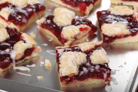 Cherry cobbler bars on a cookie sheet.
