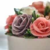 Decorated cake with icing roses.
