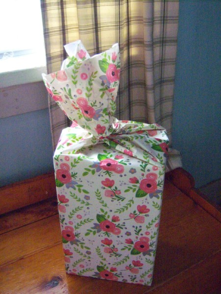 Flower Gift Wrapping - tape bottom and sides and then gently twist top clockwise