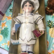 Information on Collectible Memories Porcelain Doll - doll wearing a white outfit in a box