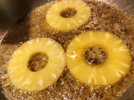 Pineapple added to brown sugar and butter in pan