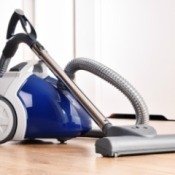 Canister vacuum on a wood floor.