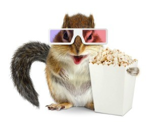 Chipmunk wearing 3D glasses holding a box of popcorn.