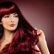 Woman with dark red hair.