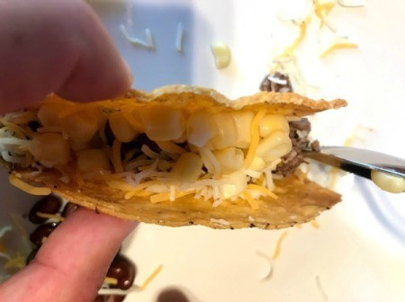 hand held filled Taco