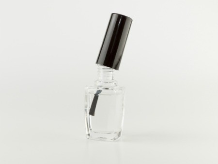 Clear nail polish on white background.