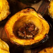 Baked acorn squash halves with pecans.
