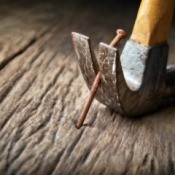 Hammer Claw Removing Nail from wood board