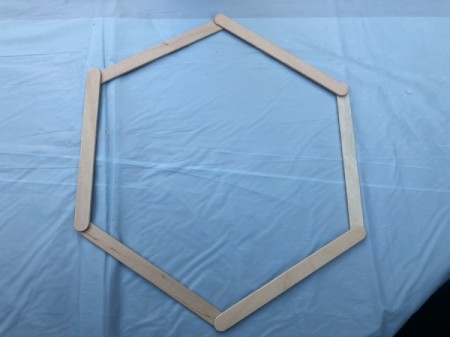 Honeycomb Shadow Shelf - lay out 6 sticks in a hexagon shape as shown
