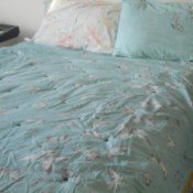 Tufting a Comforter - tufted comforter on bed