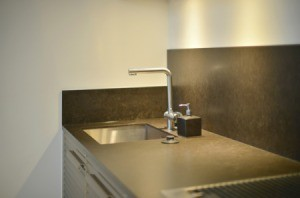 Grey laminate countertop with a sink.
