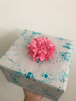 Wrapping Paper and Bow Made from Packaging Items - wrapped gift