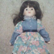 Information on a Porcelain Doll - doll wearing a blue and pink floral dress