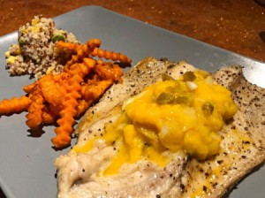 Baked Fish with Mango Jalapeno Relish on dinner plate