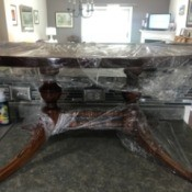 Value of a Mersman Coffee Table - plastic wrapped oval coffee table