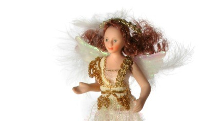 Angel doll with feather wings.