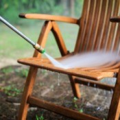 Pressure washing outdoor wooden chair.