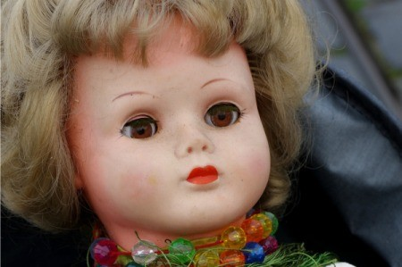 Face of an old porcelain doll.