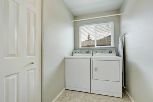 Washer and dryer in a small room with window.