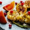 Chicken legs with cranberries and oranges.
