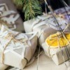 Butcher paper wrapped gifts embellished with paper snowflakes and dried orange slices.