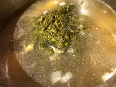 spinach and broth added to pot