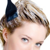 Blond woman with hair dye in her hair.