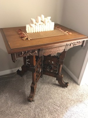 Value of Antique Parlor Table  - ornately carved small table