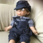 Identifying a Porcelain Doll - boy doll wearing a cap, plaid shirt and overalls