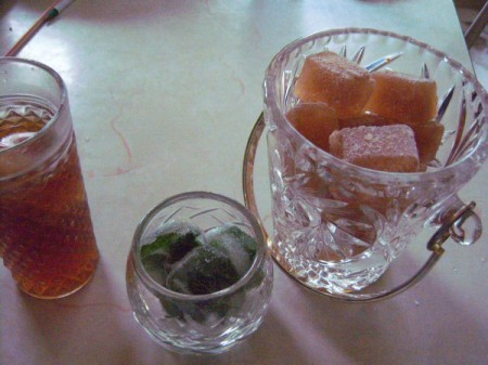 Cubes of frozen iced tea and spearmint.