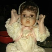 Identifying a Porcelain Doll - baby doll wearing a one piece outfit
