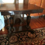 Identifying a Mersman Table - dark stain table with two turned supports and a base with four legs