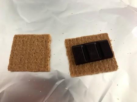 chocolate on graham cracker on foil