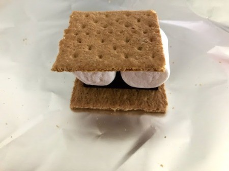 uncooked S'more sandwich on foil