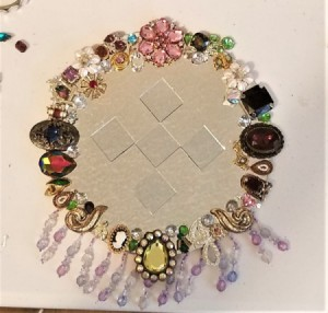 BeJeweled' Mirror = finished mirror with mirror tiles in center