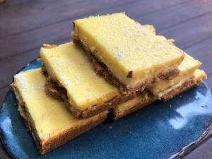 Zesty Lime Cheesecake Bars stacked on plate