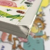 A board book with a damaged and bent spine, due to poor packaging during shipping.