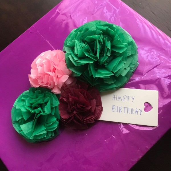 Tissue paper flower bow thriftyfun you can make a simple one or a couple with tissue paper tissue paper flower bows will make a cute accent to any gift youre going to give mightylinksfo