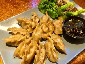 Potstickers on plate with dipping sauce