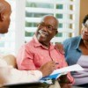 Financial advisor going over some notes with senior couple