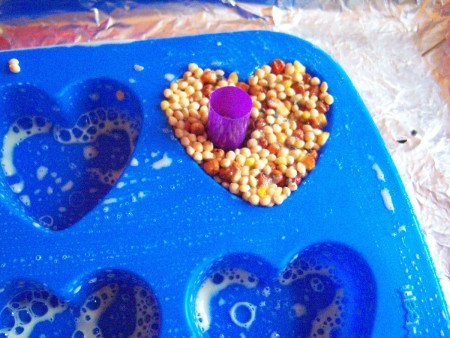 Bird Seed Heart Wedding Favors - press cut straws into the center of the seed heart