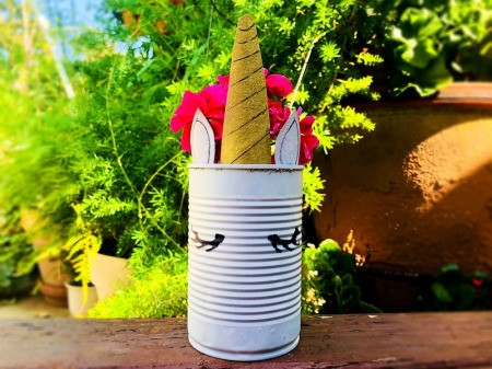 Tin Can Unicorn Planter - flower filled can outside