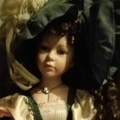 Identifying a Porcelain Doll - doll dressed in period attire of green and tan