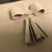 Simple Tassel Bow Gift Topper - choosing a good spot for the bow
