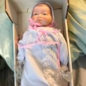 Identifying Porcelain Dolls - baby doll in a box
