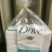 A plastic wrapper from a package of Dove bar soap inside a plastic bag.